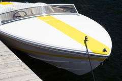 White boat with yellow stripe Stock Photo