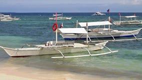 White boats near shore. White sandy beach near the boat stock video footage