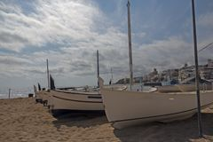 White boats on the sand. Fishing boats on the shores of the town of Sant Pol de Mar royalty free stock photography