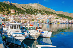 White boats in small cosy port on Greek Island Stock Images