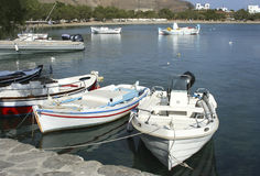White boats. White small boats at seashore royalty free stock photos