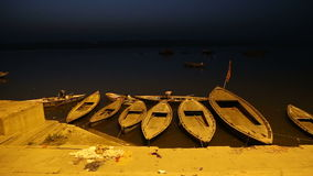 White boats tied to the dock of Ganges river in the night time. stock video