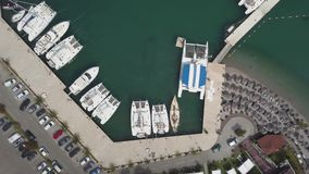 White boats, yachts and catamarans parked in marina. Aerial footage of boats, yachts and catamarans parked in marina stock video