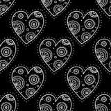 White boho ornamental hearts on black background seamless pattern. Vector boho ornamental hearts seamless pattern on black background. Can be printed and used as Stock Photo