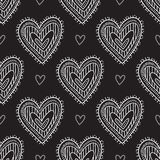 White boho ornamental hearts on black background seamless pattern. Vector boho ornamental hearts seamless pattern on black background. Can be printed and used as Royalty Free Stock Photo