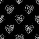 White boho ornamental hearts on black background seamless pattern Royalty Free Stock Images