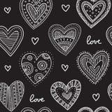 White boho ornamental hearts on black background seamless pattern Stock Photos