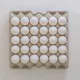 White boiled eggs in a recycled paper tray Royalty Free Stock Photos