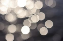 White bokeh on dark blue background close-up, texture stock photo