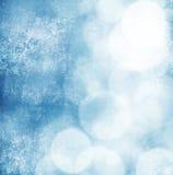 White bokeh on grungy blue background Stock Image