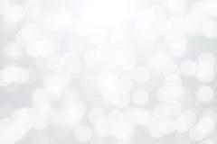 White bokeh lights on gray background.  Royalty Free Stock Photo