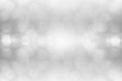 White bokeh lights on gray background.  Stock Photos