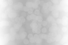 White bokeh lights on gray background.  Royalty Free Stock Images