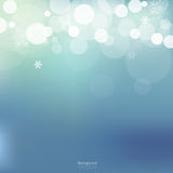 White bokeh and snowflakes on light blue background. Christmas and festive theme Stock Images