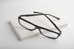 White book with black glasses Stock Image