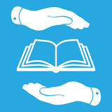 White book icon in flat hands isolated on blue background Stock Photography