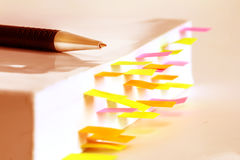 White book marked by sticky note. Close up White book marked by sticky note Royalty Free Stock Photos