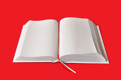 White book on red plate. Big white book on simply red plate Royalty Free Stock Photos