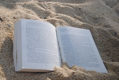 White Book on Sand during Daytime Stock Images