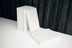 White books leaning on wooden wall Stock Image