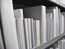 White Books in a Shelf Stock Photo