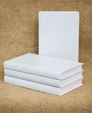 White books on the textile background Royalty Free Stock Images