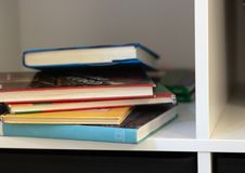The White Bookshelf and several books lying in disarray stock photography