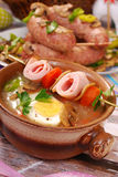 White borscht with rolled ham on skewer for easter Stock Image