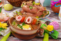 White borscht with rolled ham on skewer for easter Royalty Free Stock Photo
