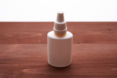 White bottle of nasal drops Royalty Free Stock Image