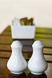 White  bottle of salt and pepper Royalty Free Stock Image