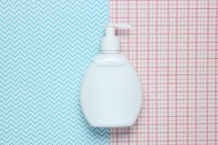 White bottle of shampoo on creative background, top view. stock image
