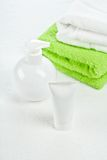 White Bottle Tube And Towels Stock Photography