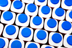 White bottles with blue plastic covers with dairy also turned sour dairy products Close up  on a white background Royalty Free Stock Image