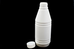 White bottles of medicines on black isolated Stock Photography