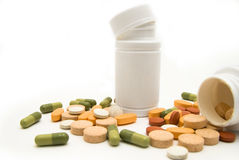 White bottles and pills macro Royalty Free Stock Photography