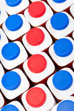 White bottles with red and blue covers with dairy products Stock Photo