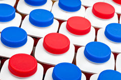 White bottles with red and blue plastic covers with dairy also turned sour dairy products Close up  on a white background Royalty Free Stock Photos