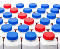 White bottles with red and blue plastic covers with dairy also turned sour dairy products on a white background Royalty Free Stock Photo