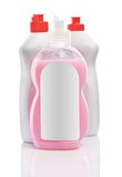 White bottles with red lids and pink cream Royalty Free Stock Photos