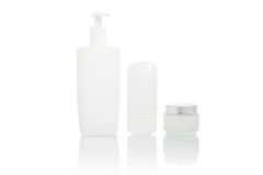 White bottles set (beauty hygiene container). White bottles and container set (Plastic pump soap bottle, cosmetic cream in container, beauty hygiene container) Stock Photo