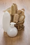 White bottles and wooden bucket Stock Image