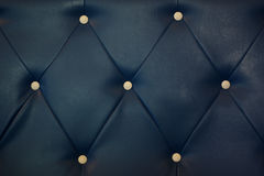 White bottoned on blue leather pattern background Stock Photography