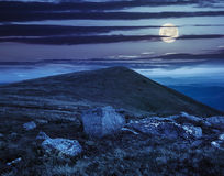 White boulders on the hillside at night Stock Image