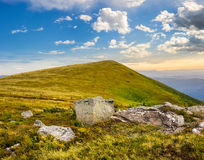 White boulders on the hillside at sunrise Stock Images