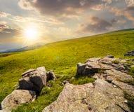 White boulders on the hillside at sunset Stock Image