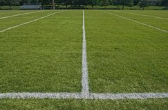 White boundary lines of football playing field. White boundary lines of American football playing field stock image