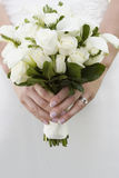 White bouquet. Wedding flowers in pure white, roses and lilies Royalty Free Stock Image