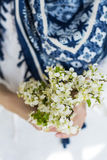 White bouquet of blooming spring flowers in the hands Stock Image