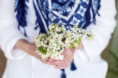 White bouquet of blooming spring flowers in the hands Royalty Free Stock Image